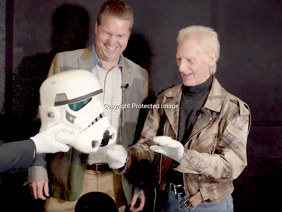 BNPS.co.uk (01202 558833)<br /> Pic: PropStore/BNPS<br /> <br /> Actor Syd Wragg(r) is reunited with his helmet by current owner John Holt(l).<br /> <br /> A Stormtrooper helmet from the first Star Wars film has sold for almost £200,000 by a relative of a British country squire.<br /> <br /> Captain Robert Hawkins and his wife Anne were gifted the iconic helmet for staging the Star Wars Cross Country Team Event at their English manor house in 1978.<br /> <br /> The bizarre equestrian event was attended by Carrie Fisher, who played Princess Leia, Darth Vader actor David Prowse, Peter Mayhew, who played Chewbacca, and football pundit Jimmy Hill.