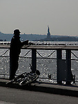 Silhouette of fisherman.Images of New York 2004, New York,U.S.A