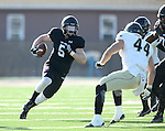SIOUX FALLS, SD, NOVEMBER 26:  Brady Rose #5 from the University of Sioux Falls looks for running room around  Daylan Skidmore #44 from Harding University Saturday afternoon at Bob Young Field in Sioux Falls. (Photo by Dave Eggen/Inertia)