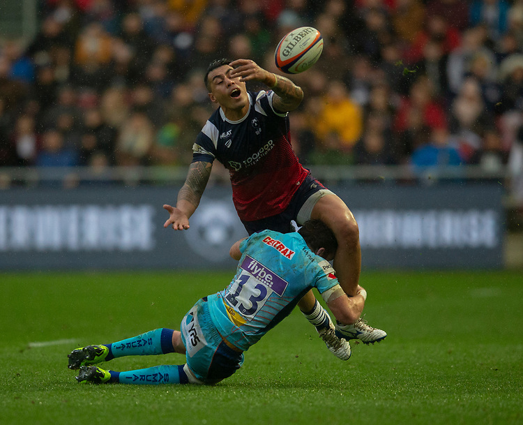 Bristol Bears' Tusi Pisi is tackled by Exeter Chiefs' Max Bodilly<br /> <br /> Photographer Bob Bradford/CameraSport<br /> <br /> Premiership Rugby Cup Round 4 - Bristol Bears v Exeter Chiefs - Saturday 26th January 2019 - Ashton Gate - Bristol<br /> <br /> World Copyright © 2018 CameraSport. All rights reserved. 43 Linden Ave. Countesthorpe. Leicester. England. LE8 5PG - Tel: +44 (0) 116 277 4147 - admin@camerasport.com - www.camerasport.com