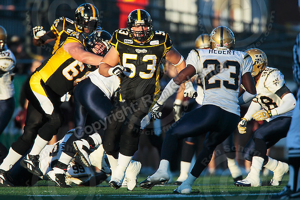 Aug 3, 2007; Hamilton, ON, CAN; Winnipeg Blue Bombers play the Hamilton Tiger-Cats at Ivor Wynne Stadium. The Tiger-Cats defeated the Blue Bombers 43-22. Mandatory Credit: Ron Scheffler. Pictured here is Hamilton Tiger-Cats centre (53) Cedric Gagne-Marcoux.