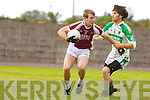 Sean Walsh Cromane is tackled by John Enright Ballydonohue during their league game in Cromane on Sunday