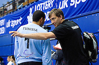 06 APR 2012 - LONDON, GBR - Tunisian goalkeeping coach Mehemedalija Mulabdic (right) passes on advice to Tunisian goalkeeper Makrem Missaoui (TUN) during the men's 2012 London Cup match at the National Sports Centre in Crystal Palace, Great Britain (PHOTO (C) 2012 NIGEL FARROW)