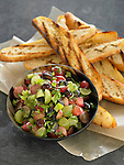 Bowl of grape salsa with grilled bread