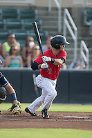Eddy Alvarez (1) of the Kannapolis Intimidators follows through on his swing against the Asheville Tourists at Intimidators Stadium on June 25, 2015 in Kannapolis, North Carolina.  The Intimidators defeated the Tourists 9-8.  (Brian Westerholt/Four Seam Images)