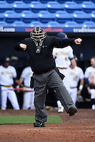 Home plate umpire Dorsey Hager makes a calling during the second game of a doubleheader between the Siena Saints and Michigan Wolverines on February 27, 2015 at Tradition Field in St. Lucie, Florida.  Michigan defeated Siena 6-0.  (Mike Janes/Four Seam Images)