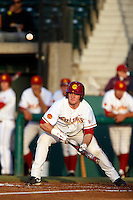 Turner Clouse #22 of the USC Trojans bunts during a game against the Arizona State Sun Devils at Dedeaux Field on April 12, 2013 in Los Angeles, California. USC defeated Arizona State, 5-0. (Larry Goren/Four Seam Images)