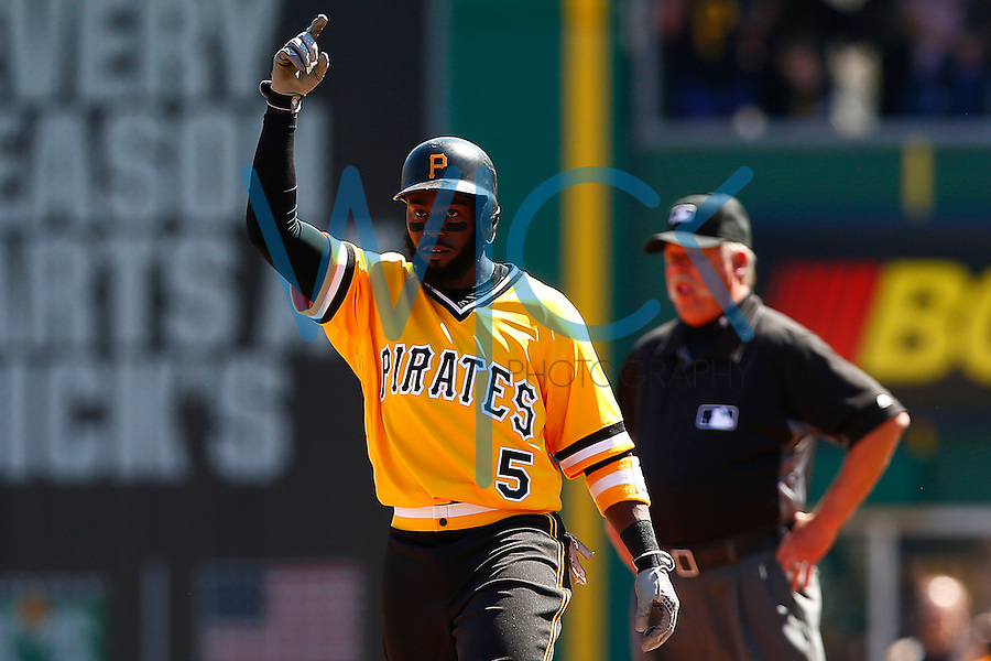 Josh Harrison #5 of the Pittsburgh Pirates reacts following his RBI single in the third inning against the Milwaukee Brewers during the game at PNC Park in Pittsburgh, Pennsylvania on April 17, 2016. (Photo by Jared Wickerham / DKPS)