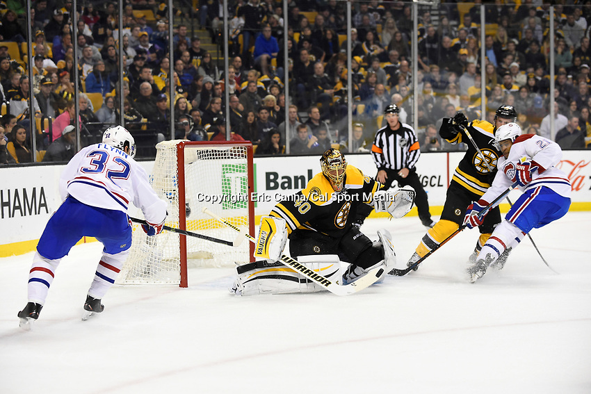 Saturday, October 10, 2105: Boston Bruins goalie Tuukka Rask (40) makes a save on a shot from Montreal Canadiens right wing Brian Flynn (32) as right wing Devante Smith-Pelly (21) looks for the rebound  during the NHL game between the Montreal Canadiens and the Boston Bruins held at TD Garden, in Boston, Massachusetts. Eric Canha/CSM