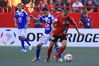 TIJUANA -MÉXICO, 10-04-2013. Jorge Hernandez (D) de Tijuana y Luis Mosquera (I) de Millonarios durante el juego de la fase de grupos de la Copa Libertadores 2013 en el Estadio Caliente en Tijuana, Mexico./  Jorge Hernandez (r) of Tijuana and  Luis Mosquera (l) of Millonarios fights for tha ball during match of the groups stage of Libertadores Cup 2013 at Caliente stadium in Tijuana, Mexico  Photo: Fausto Vargas /JAM MEDIA/VizzorImage