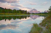 Path to reflection. A foot path along the Oxbow Bend of the Snake River leads the eye into the photo.  Sunrise at Oxbow Bend in Grand Teton National Park<br />