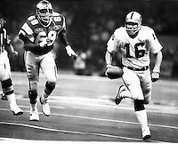 Raider Philly Super Bowl. XV...QB Jim Plunkett runs away from Eagle lineman, 1981. Photo by Ron Riesterer .