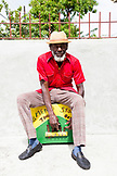 "JAMAICA, Port Antonio. Derrick ""Johnny"" Henry of the Mento band, The Jolly Boys, sitting and playing the marumba box."