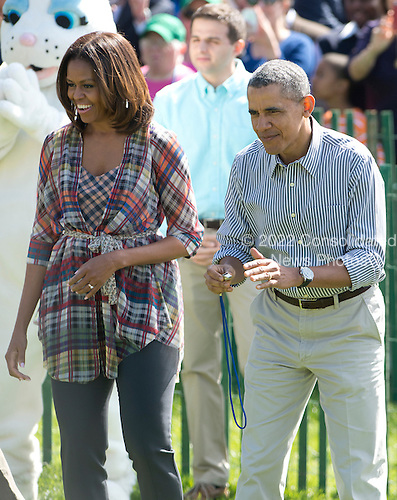 United States President Barack Obama, right, and First Lady Michelle Obama, left, participate in the White House Easter Egg Roll on the South Lawn of the White House in Washington, D.C. on Monday, April 21, 2014.<br /> Credit: Ron Sachs / CNP