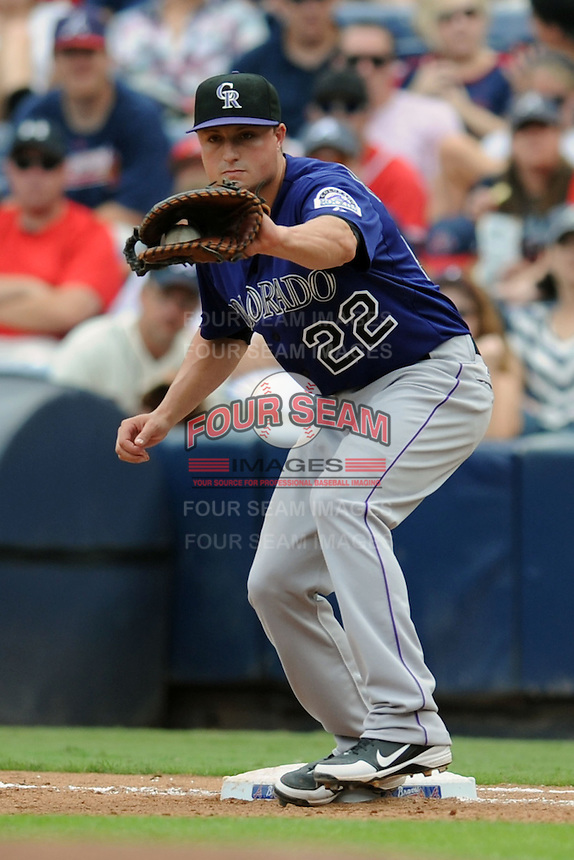 Colorado Rockies first baseman Jordan Pacheco #22 takes a throw during a game against the Atlanta Braves at Turner Field on September 3, 2012 in Atlanta, Georgia. The Braves  defeated the Rockies 6-1. (Tony Farlow/Four Seam Images).