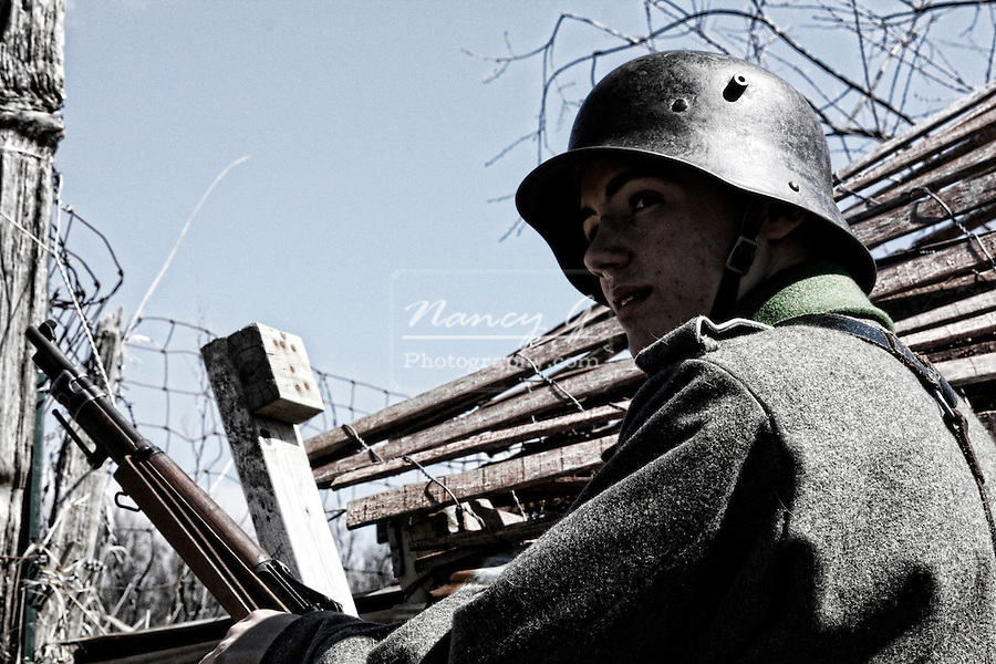 German Reenactors during a WW1 Reenactment at Midway Village going over the wall