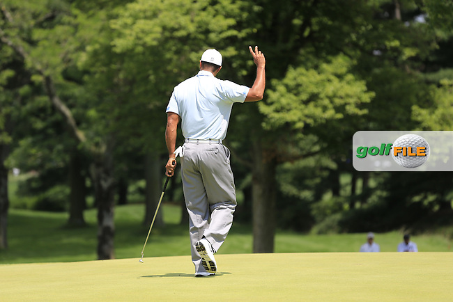 Tiger Woods (USA) sinks his birdie putt on the 1st green during Saturday's Round 3 of the 2013 Bridgestone Invitational WGC tournament held at the Firestone Country Club, Akron, Ohio. 3rd August 2013.<br /> Picture: Eoin Clarke www.golffile.ie