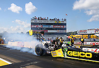 Aug 15, 2014; Brainerd, MN, USA; NHRA top fuel dragster driver Richie Crampton during qualifying for the Lucas Oil Nationals at Brainerd International Raceway. Mandatory Credit: Mark J. Rebilas-