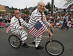 Two riders dressed as former President Ronald Reagan (L) and  President George W. Bush attended tin the 21st annual Summer Solstice Parade held Saturday, June 20, 2009 in Seattle, Wa. ).The parade was held Saturday, bringing out painted and naked bicyclists, bands, belly dancers and floats. (Jim Bryant Photo © 2009)