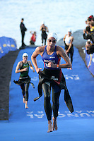 09 MAY 2004 - FUNCHAL, MADEIRA - Helen Tucker (GBR) races to T1 during the u23 Womens World Triathlon Championships. (PHOTO (C) NIGEL FARROW)