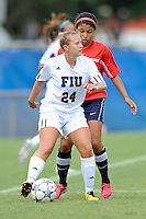 2 October 2011:  FIU's Cortney Bergin (24) looks to pass the ball in the first half as the FIU Golden Panthers defeated the University of South Alabama Jaguars, 2-0, at University Park Stadium in Miami, Florida.