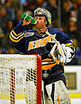 16 November 2008: Merrimack College Warriors' goaltender Andrew Braithwaite, a Junior from Kingston, Ontario, pauses for some hydration while facing the University of Vermont Catamounts at Gutterson Fieldhouse, in Burlington, Vermont. The Catamounts defeated the Warriors 2-1 in front of a near-capacity crowd of 3,813...Mandatory Photo Credit: Ed Wolfstein Photo