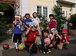 Japanese children wearing Chelsea and Bayern Munich soccer uniforms kids gather outside early on Monday morning to watch as the moon passes in front of the sun during an annular solar eclipse in Saitama, just outside Tokyo, Japan on Monday May 21st, 2012. This was the first time in 173 years that an annualar solar eclipse was visible from Tokyo.