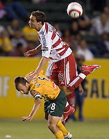 Mark Wilson leaps over Pete Vagenas for a header in the US Open Cup at the Home Depot Center, in Carson, Calif., Wednesday, September 28, 2005.