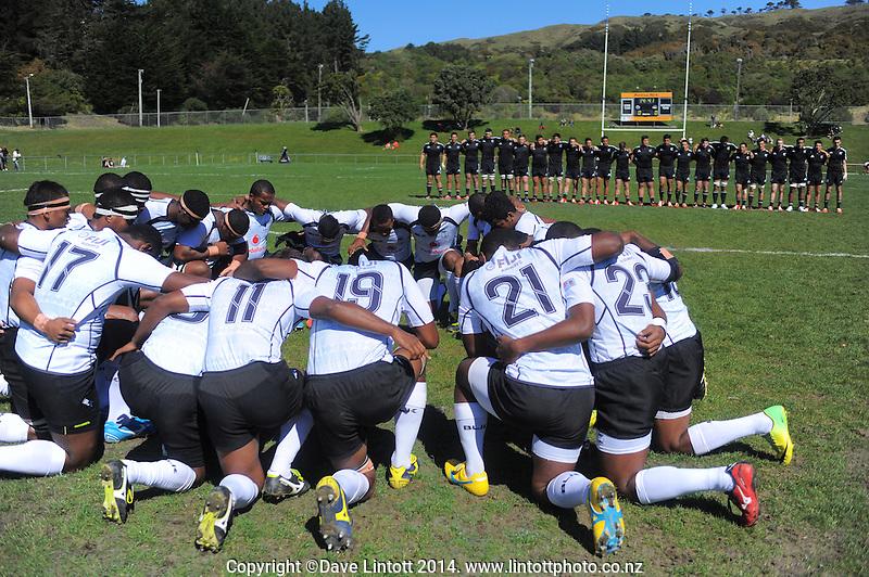 The Fiji team huddle before the rugby union match between NZ Schools and Fiji Schools at Porirua Park, Porirua, Wellington, New Zealand on Tuesday, 30 September 2014. Photo: Dave Lintott / lintottphoto.co.nz