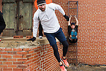 December 22, 2014. Lexington, North Carolina.<br />  Mayor Newell Clark does leg lifts on a ladder at the abandoned Lexington Furniture factory as other members of his workout group use the loading dock as a climbing obstacle.<br />  Newell Clark, the 43 year old mayor of Lexington, NC, leads a group of friends and colleagues on a 4 times a week exercise routine around downtown. The group uses existing infrastructure, such as an abandoned furniture factory, loading docks, stairs, and handrails to get fit and increase awareness of healthy lifestyles in a town more known for BBQ.<br /> Jeremy M. Lange for the Wall Street Journal<br /> Workout_Clark