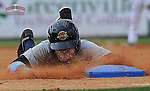 Ben Gamel (3) of the Charleston RiverDogs slides headfirst into third base in a game against the Greenville Drive on June 24, 2012, at Fluor Field at the West End in Greenville, South Carolina. The bases were painted blue for colon cancer awareness day. (Tom Priddy/Four Seam Images)