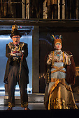 London, UK. 2 March 2016. Clive Bayley as Aye and Rebecca Bottone as Queen Tye. English National Opera (ENO) dress rehearsal of the Philip Glass opera Akhnaten at the London Coliseum. 7 performances from 4  to 18 March 2016. Directed by Phelim McDermott with Anthony Roth Costanzo as Akhnaten, Emma Carrington as Nefertiti, Rebecca Bottone as Queen Tye, James Cleverton as Horemhab, Clive Bayley as Aye, Colin Judson as High Priest of Amon and Zachary James as Scribe. Skills performances by Gandini Juggling.