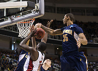 March 21st, 2013: California's Richard Solomon blocks the ball away from UNLV's Anthony Bennet during a game at HP Pavilion, San Jose, California. California defeated UNLV 64 - 61