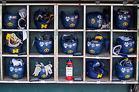 Michigan Wolverines helmet rack before Game 2 of the NCAA College World Series Finals on June 25, 2019 at TD Ameritrade Park in Omaha, Nebraska. Vanderbilt defeated Michigan 4-1. (Andrew Woolley/Four Seam Images)