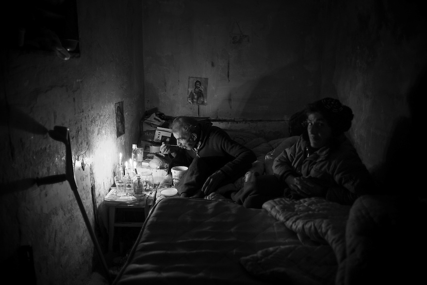 An elderly couple lives in the basement of a drug den in a middle class neighborhood of Bucharest. Romania's capital city has a population of estimated 6000 homeless, many of whom shelter underground especially during winter months.