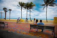Couple watch activity along Hollywood Beach Boardwalk, Hollywood, Florida, USA. Photo by Debi Pittman Wilkey