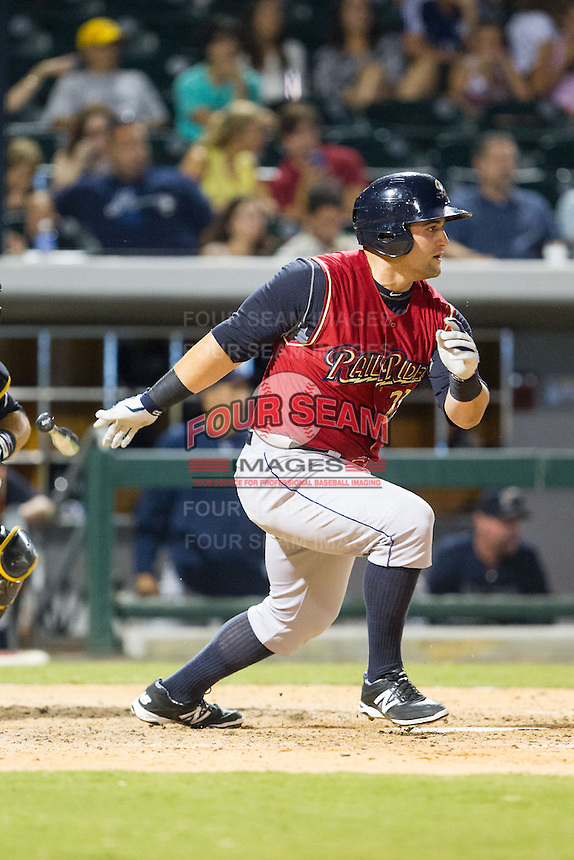 Kyle Roller (23) of the Scranton/Wilkes-Barre RailRiders follows through on his swing against the Charlotte Knights at BB&T Ballpark on July 17, 2014 in Charlotte, North Carolina.  The Knights defeated the RailRiders 9-5.  (Brian Westerholt/Four Seam Images)