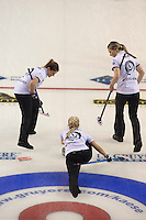 Glasgow. SCOTLAND.  Scotland's, Anna SLOAN,  pushing through to deliver her &quot;Stone&quot;, team mates left, Vicki ADAMS and right, Lauren GRAY, watch on during a &quot;Round Robin&quot; Game. Le Gruy&egrave;re European Curling Championships. 2016 Venue, Braehead  Scotland<br /> Tuesday  22/11/2016<br /> <br /> [Mandatory Credit; Peter Spurrier/Intersport-images]