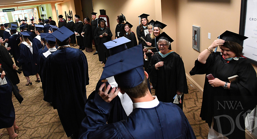 NWA Democrat-Gazette/J.T. WAMPLER Graduates get in place while walking through a gauntlet of facility and staff Thursday May 18, 2017 before commencement ceremonies for Shiloh Christian School in Springdale. The school graduated 71 seniors.