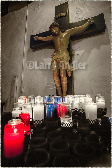 Crucifix and votive candles, Mission San Gabriel Arcángel, forth of the 21 California Missions and founded by Father Junipero Serra, September 8, 1771.