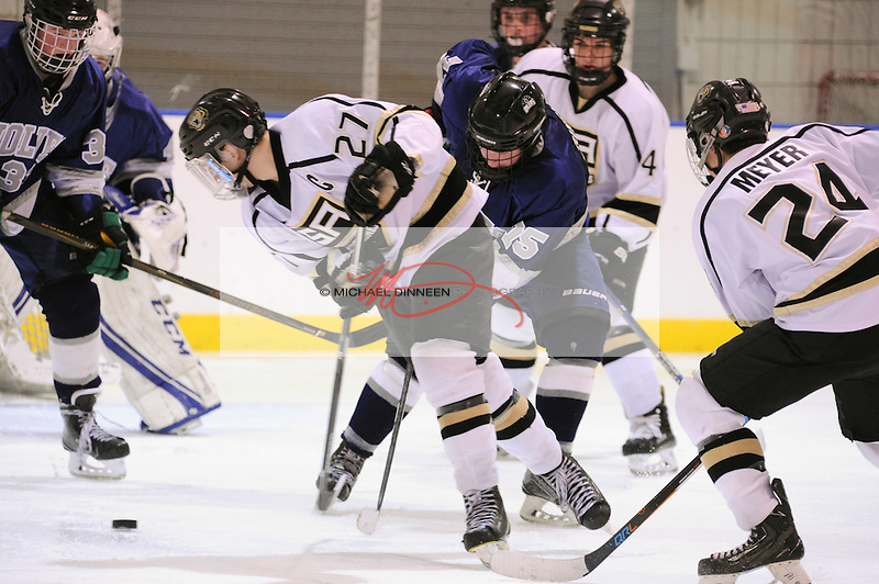 From left, Eagle River's Logan Dudinsky and Ben Rinckey find themselves battling a quartet of Cougars during overtime of their 2-2 tie with Service at Ben Boeke Arena Thursday, November 17, 2016.  Photo for the Star by Michael Dinneen
