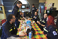 Switzerland. Canton Ticino. Pregassona. Croce Verde Lugano Headquarters. Team paramedics enjoys a breakfast together on a Saturday morning.The paramedics wear blue uniforms and work for the Croce Verde Lugano. Some are professional certified nurses, others are volunteers specifically trained in emergency rescue.The Croce Verde Lugano is a private organization which ensure health safety by addressing different emergencies services and rescue services. Volunteering is generally considered an altruistic activity where an individual provides services for no financial or social gain to benefit another person, group or organization. Volunteering is also renowned for skill development and is often intended to promote goodness or to improve human quality of life. Pregassona is a quarter of the city of Lugano. 27.01.2018 © 2018 Didier Ruef