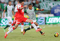 MEDELLIN - COLOMBIA-14-07-2013: McNelly Torres (Der.) jugador del Atletico Nacional disputa el balón con Daniel Torres (Izq.) jugador del Independiente Santa Fe durante partido en el estadio Atanasio Girardot de la ciudad de Medellin, julio 14 de 2013. Atletico Nacional y Indepndiente Santa Fe durante partido de ida por la final de la Liga Postobon I. (Foto: VizzorImage / Luis Rios / Str).  McNelly Torres (R) player of Atletico Nacional fights for the ball with Daniel Torres (L) player from Independiente Santa Fe during game in the Atanasio Girardot stadium in Medellin City, July 14, 2013. Atletico Nacional and Independiente Santa Fe, during match for the firsts round of finals of the Postobon League I. (Photo: VizzorImage / Luis Rios / Str).