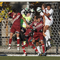 Corner kick action. Boston College defender Chris Ager (2), Boston College goalkeeper Alex Kapp (1), Boston College midfielder Giuliano Frano (15), Virginia Tech defender Drew Ranahan (3), and Virginia Tech defender Devante Dubose (21).Boston College (maroon) defeated Virginia Tech (Virginia Polytechnic Institute and State University) (white), 3-1, at Newton Campus Field, on November 3, 2013.