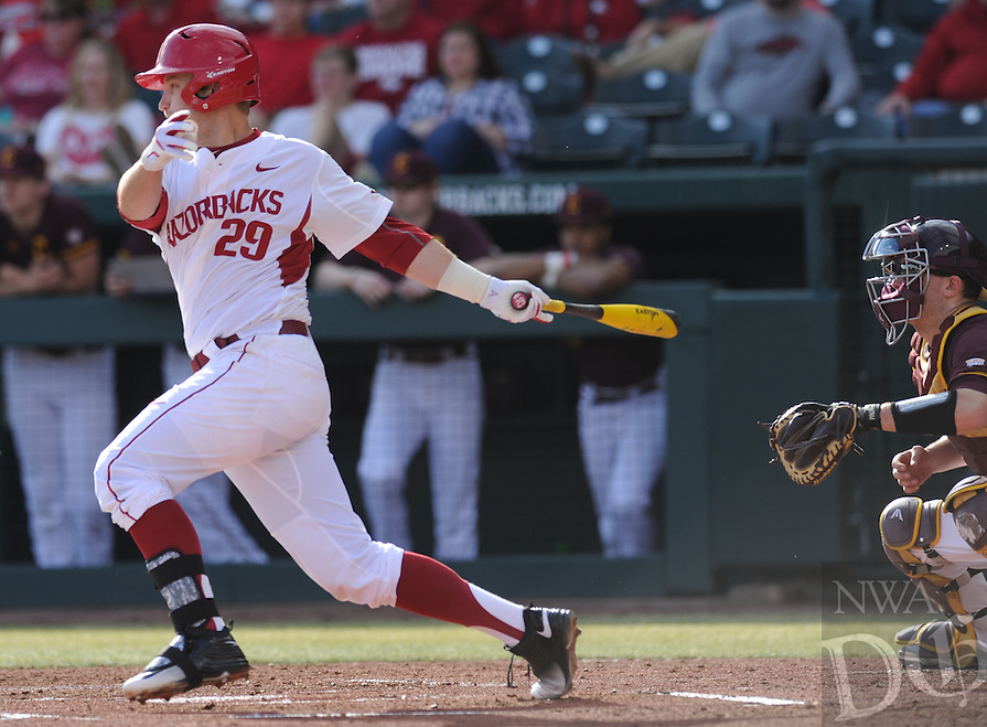NWA Democrat-Gazette/ANDY SHUPE<br />Cullen Gassaway of Arkansas records a hit against Central Michigan Friday, Feb. 19, 2016, during the first inning at Baum Stadium in Fayetteville. Visit nwadg.com/photos to see more photographs from the game.