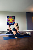 CANADA, Vancouver, British Columbia, Sharlene and her daughter Paloma practice yoga in their studio apartment in Yaletown
