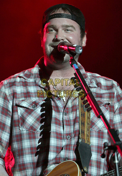 LEE BRICE.Lee Brice performs at Wild Bill's, Duluth, GA, USA, March 12th, 2010..music on stage live in concert gig microphone singing half length  plaid shirt cap hat  cross silver necklace .CAP/ADM/DH.©Dan Harr/Admedia/Capital Pictures