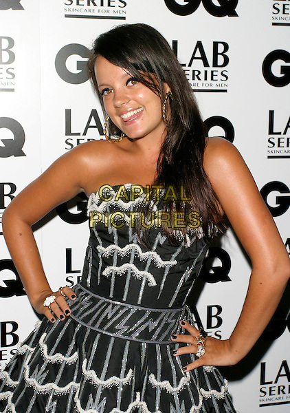 LILY ALLEN<br /> Arrivals - GQ Men Of The Year Awards,<br /> Royal Opera House, Covent Garden, London,<br /> England, September 5th 2006.<br /> half length black and white strapless prom dress hands on hips gold earrings lilly allan<br /> Ref: AH<br /> www.capitalpictures.com<br /> sales@capitalpictures.com<br /> &copy;Adam Houghton/Capital Pictures