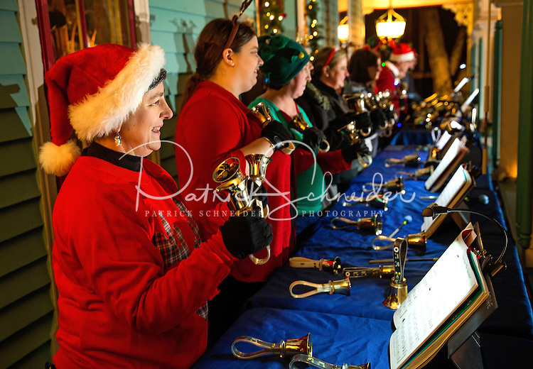 Photography of the Charlotte Bronze Handbell Ensemble performing at the the annual Fourth Ward Holiday Home Tour in Uptown Charlotte, North Carolina. This walkable, self-guided tour allows visitors to get into the Christmas holiday spirit while checking out the beautifully decorated home in Charlotte's historic Fourth Ward.  <br /> <br /> Charlotte Photographer - PatrickSchneiderPhoto.com