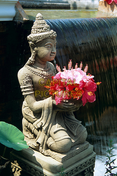 Oriental statue, flowers and fountain, Saraburi Province, Thailand